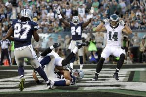 Dallas Cowboys' Sean Lee (50) intercepts a pass in the end zone against Philadelphia Eagles' Zach Ertz (86) during the second half of an NFL football game, Sunday, Sept. 20, 2015, in Philadelphia. (AP Photo/Matt Rourke)