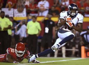 Denver Broncos wide receiver Emmanuel Sanders (10) scores a touchdown past Kansas City Chiefs defensive back Jamell Fleming (30) during the second half of an NFL football game in Kansas City, Mo., Thursday, Sept. 17, 2015. (AP Photo/Ed Zurga)