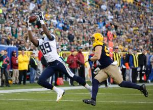 San Diego Chargers' Ladarius Green (89) makes a 19-yard touchdown reception against Green Bay Packers' Clay Matthews (52) during the second half of an NFL football game Sunday, Oct. 18, 2015, in Green Bay, Wis. (AP Photo/Jeffrey Phelps)