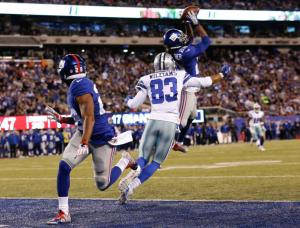 New York Giants strong safety Brandon Meriweather (22) intercepts a pass to Dallas Cowboys' Terrance Williams (83) as teammate Jayron Hosley (28) watches during the second half of an NFL football game Sunday, Oct. 25, 2015, in East Rutherford, N.J. (AP Photo/Kathy Willens)