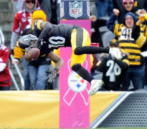 Pittsburgh Steelers wide receiver Martavis Bryant (10) flips into the end zone to score a touchdown after making a catch in the fourth quarter an NFL football game against the Arizona Cardinals, Sunday, Oct. 18, 2015 in Pittsburgh. The Steelers won 25-13. (AP Photo/Don Wright)