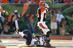 Cincinnati Bengals tight end Tyler Eifert (85) scores a touchdown against Seattle Seahawks cornerback Cary Williams (26) in the second half of an NFL football game, Sunday, Oct. 11, 2015, in Cincinnati. (AP Photo/Gary Landers)
