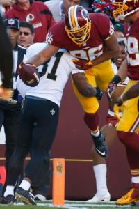 Washington Redskins tight end Jordan Reed (86) leaps over New Orleans Saints free safety Jairus Byrd (31) to score a touchdown during the first half of an NFL football game in Landover, Md., Sunday, Nov. 15, 2015. (AP Photo/Alex Brandon)