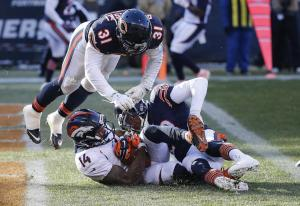 Denver Broncos wide receiver Cody Latimer (14) makes a touchdown against Chicago Bears cornerback Kyle Fuller (23) and defensive back Chris Prosinski (31) during the second half of an NFL football game, Sunday, Nov. 22, 2015, in Chicago. (AP Photo/Charles Rex Arbogast)