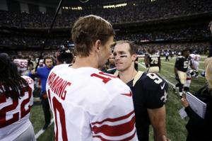 New Orleans Saints quarterback Drew Brees (9) trees New York Giants quarterback Eli Manning (10) after their NFL football game in New Orleans, Sunday, Nov. 1, 2015. The Saints won 52-49. (AP Photo/Butch Dill)
