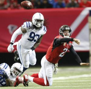 Atlanta Falcons quarterback Matt Ryan (2) tries to pass against the Indianapolis Colts during the first of an NFL football game, Sunday, Nov. 22, 2015, in Atlanta. (AP Photo/John Bazemore)