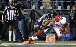 Arizona Cardinals wide receiver Michael Floyd comes down in bounds for a touchdown as Seattle Seahawks cornerback Cary Williams tries for the tackle in the first half of an NFL football game, Sunday, Nov. 15, 2015, in Seattle. (AP Photo/Elaine Thompson)