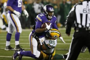 Green Bay Packers defensive end Datone Jones (95) sacked Minnesota Vikings quarterback Teddy Bridgewater (5) during the second half of an NFL football game in Minneapolis, Sunday, Nov. 22, 2015. (AP Photo/Ann Heisenfelt)