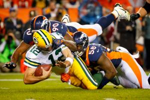Green Bay Packers quarterback Aaron Rodgers (12) is sacked by Denver Broncos defensive end Antonio Smith (90) and outside linebacker Von Miller (58) during the second half of an NFL football game, Sunday, Nov. 1, 2015, in Denver. (AP Photo/Jack Dempsey)