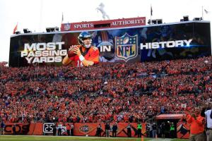 DENVER, CO - NOVEMBER 15:  The scoreboard commemorates the occation as quarterback Peyton Manning #18 of the Denver Broncos sets the NFL career passing yards record with a four yard completion to Ronnie Hillman #23 of the Denver Broncos against the Kansas City Chiefs in the first quarter at Sports Authority Field at Mile High on November 15, 2015 in Denver, Colorado. Mannning passes Bret Farve who previously held the record at 71, 838 yards.  (Photo by Doug Pensinger/Getty Images)