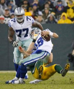 Green Bay Packers' Clay Matthews tackles Dallas Cowboys' Matt Cassel (16) during the first half of an NFL football game Sunday, Dec. 13, 2015, in Green Bay, Wis. (AP Photo/Mike Roemer)