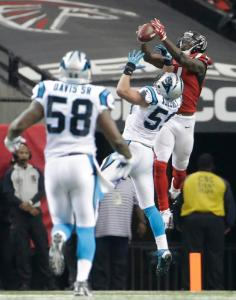Atlanta Falcons wide receiver Julio Jones (11) catches the ball against Carolina Panthers middle linebacker Luke Kuechly (59) during the second half of an NFL football game, Sunday, Dec. 27, 2015, in Atlanta. (AP Photo/David Goldman)