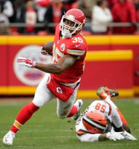 Kansas City Chiefs running back Charcandrick West (35) runs past Cleveland Browns linebacker Chris Kirksey (58) during the first half of an NFL football game in Kansas City, Mo., Sunday, Dec. 27, 2015. (AP Photo/Charlie Riedel)