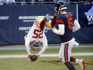 San Francisco 49ers strong safety Jimmie Ward (25) dives to the end zone for a touchdown after intercepting a pass as Chicago Bears quarterback Jay Cutler (6) watches during the first half of an NFL football game, Sunday, Dec. 6, 2015, in Chicago. (AP Photo/Charles Rex Arbogast)