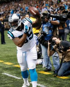 Carolina Panthers fullback Mike Tolbert (35) celebrates his touchdown in the first half of an NFL football game against the New Orleans Saints in New Orleans, Sunday, Dec. 6, 2015. (AP Photo/Bill Feig)