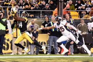 Pittsburgh Steelers wide receiver Antonio Brown (84) makes a touchdown catch past Denver Broncos cornerback Chris Harris (25) in the second half of an NFL football game, Sunday, Dec. 20, 2015, in Pittsburgh. (AP Photo/Fred Vuich)
