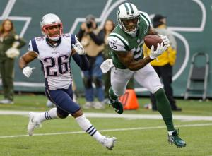 New York Jets wide receiver Brandon Marshall (15) catches a pass for a touchdown in front of New England Patriots' Logan Ryan (26) during the second half of an NFL football game, Sunday, Dec. 27, 2015, in East Rutherford, N.J. (AP Photo/Seth Wenig)