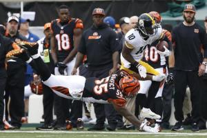 Cincinnati Bengals outside linebacker Vontaze Burfict (55) tackles Pittsburgh Steelers wide receiver Martavis Bryant (10) in the first half of an NFL football game, Sunday, Dec. 13, 2015, in Cincinnati. (AP Photo/Gary Landers)