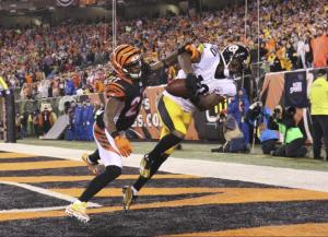 Pittsburgh Steelers' Martavis Bryant (10) makes a 10-yard touchdown reception against Cincinnati Bengals' Dre Kirkpatrick (27) during the second half of an NFL wild-card playoff football game Saturday, Jan. 9, 2016, in Cincinnati. (AP Photo/Gary Landers)