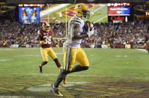 Green Bay Packers wide receiver Davante Adams (17) pulls in a touchdown pass as Washington Redskins free safety Dashon Goldson (38) closes in during the first half of an NFL wild card playoff football game in Landover, Md., Sunday, Jan. 10, 2016. (AP Photo/Nick Wass)