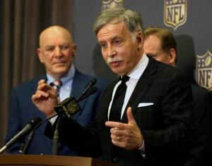 St. Louis Rams owner Stan Kroenke talks to the media after team owners voted Tuesday, Jan. 12, 2016, in Houston, to allow the Rams to move to a new stadium just outside Los Angeles, and the San Diego Chargers will have an option to share the facility. Houston Texans owner Bob McNair stands to his left. (AP Photo/Pat Sullivan)