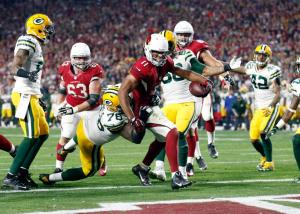 Arizona Cardinals wide receiver Larry Fitzgerald (11) scores the game-winning touchdown against the Green Bay Packers during overtime of an NFL divisional playoff football game, Saturday, Jan. 16, 2016, in Glendale, Ariz. The Cardinals won 26-20 in overtime. (Rob Schumacher/The Arizona Republic via AP) MARICOPA COUNTY OUT; MAGS OUT; NO SALES; MANDATORY CREDIT