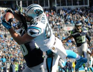 Carolina Panthers tight end Greg Olsen (88) makes a touchdown catch against Seattle Seahawks cornerback Jeremy Lane (20) during the first half of an NFL divisional playoff football game, Sunday, Jan. 17, 2016, in Charlotte, N.C. (AP Photo/Mike McCarn)