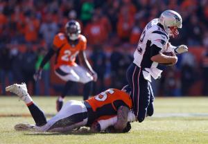 Denver Broncos defensive end Derek Wolfe (95) sacks New England Patriots quarterback Tom Brady during the first half the NFL football AFC Championship game between the Denver Broncos and the New England Patriots, Sunday, Jan. 24, 2016, in Denver. (AP Photo/David Zalubowski)