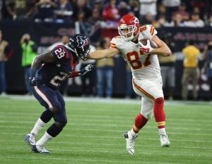 Kansas City Chiefs tight end Travis Kelce (87) tries to fend off Houston Texans free safety Andre Hal (29) during the second half of an NFL wild-card playoff football game Saturday, Jan. 9, 2016, in Houston. (AP Photo/Eric Christian Smith)