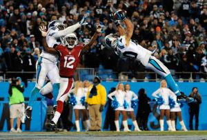 CHARLOTTE, NC - JANUARY 24: Kurt Coleman #20 of the Carolina Panthers intercepts a pass intended for John Brown #12 of the Arizona Cardinals at the end of the first half during the NFC Championship Game at Bank of America Stadium on January 24, 2016 in Charlotte, North Carolina. (Photo by Jared C. Tilton/Getty Images)