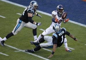 Denver Broncos' Von Miller (58) strips the ball from Carolina Panthers' Cam Newton (1) during the first half of the NFL Super Bowl 50 football game Sunday, Feb. 7, 2016, in Santa Clara, Calif. The Broncos recovered the ball for a touchdown. (AP Photo/Charlie Riedel)